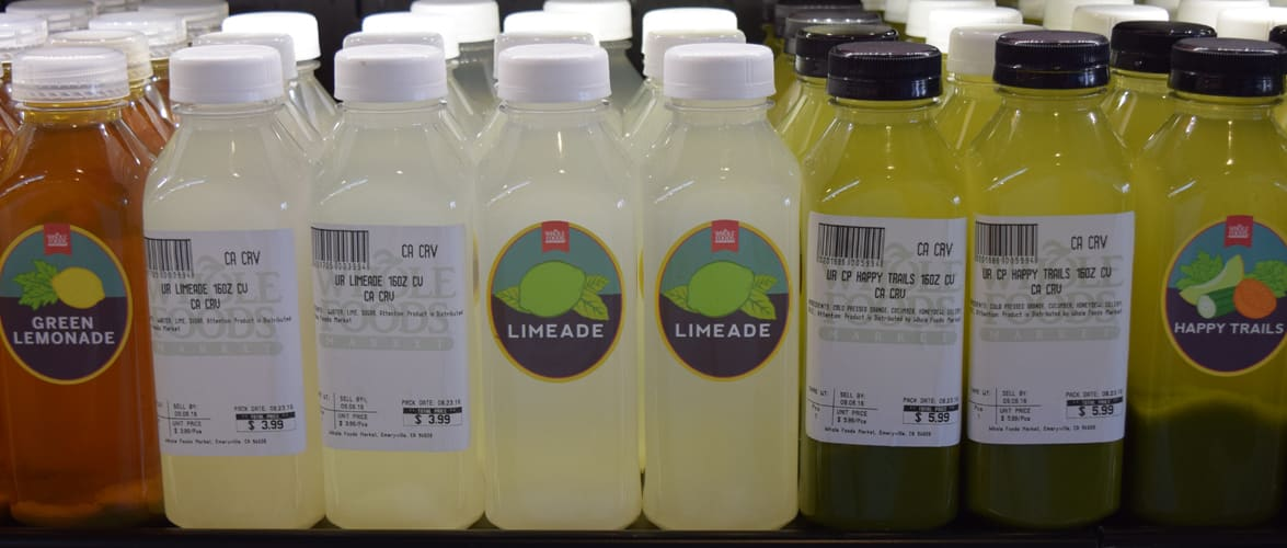 Whole Foods Market Juices with complex and simple labels alternatively facing forward.