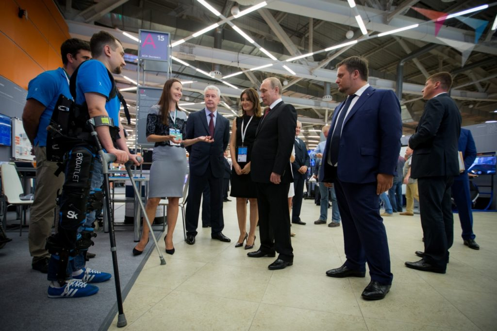 ExoAtlet CEO Ekaterina Bereziy telling Vladimir Putin about her company's exoskeletons while one is demonstrated. Photo: Kremlin.ru,