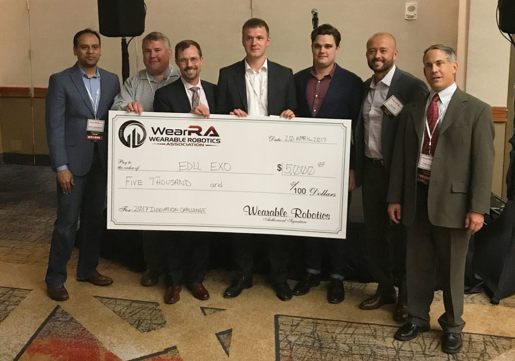 The WearRA Leadership Team and Sean Petterson from StrongArm Technologies present the main prize to EduExo