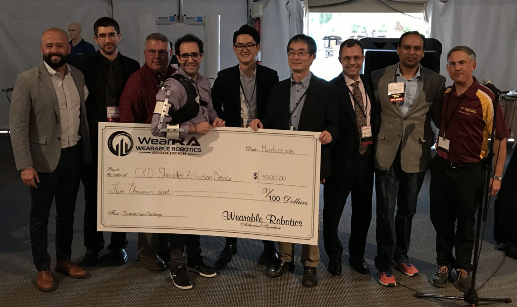 Miguel Nobre Castro with Sponsor Michael Kim StrongArm Tech and the WearRA executive team